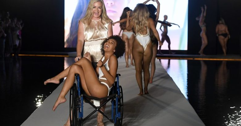 MIAMI BEACH, FLORIDA - JULY 14:  Djaniel Carter and MJ Day walk the runway during the 2019 Sports Illustrated Swimsuit Runway Show During Miami Swim Week At W South Beach - Runway at WET poolside lounge at W South Beach on July 14, 2019 in Miami Beach, Florida. (Photo by Frazer Harrison/Getty Images for Sports Illustrated)